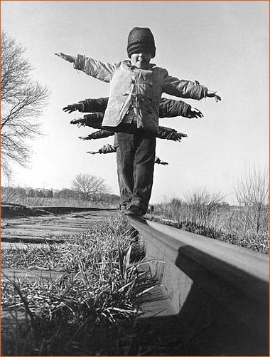 Children balance on rail in South Dakota.