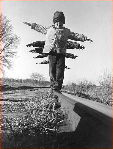 Children balance on rail in South Dakota.
